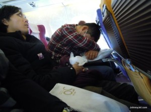 Sleeping-On-A-plane-610x457